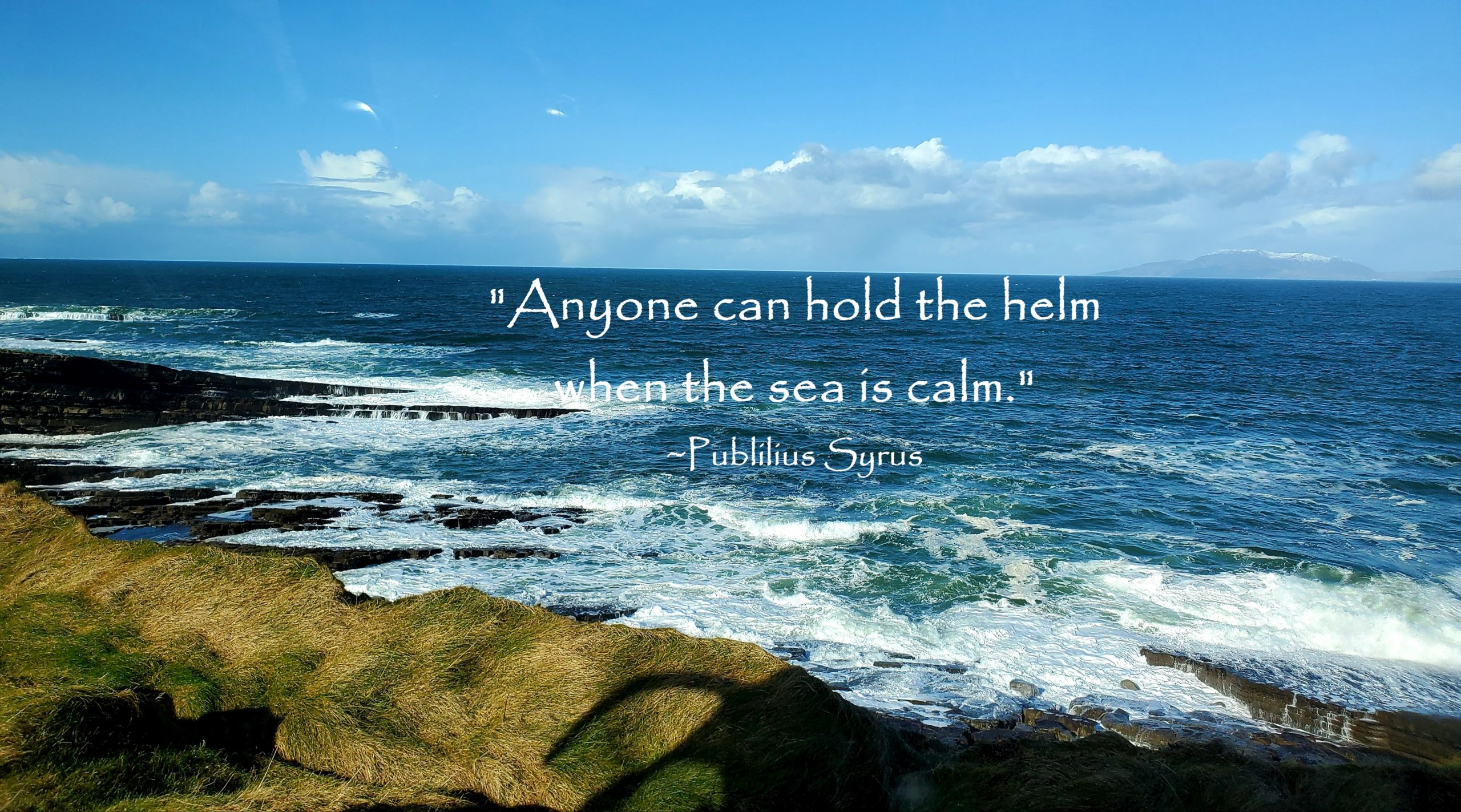 Irish sea with quote Anyone can hold the helm when the sea is calm by Publilius Syrus